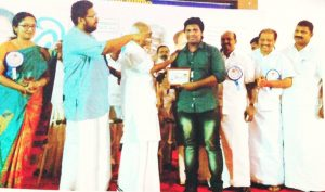 AKHIL G Receiving Award from Minister